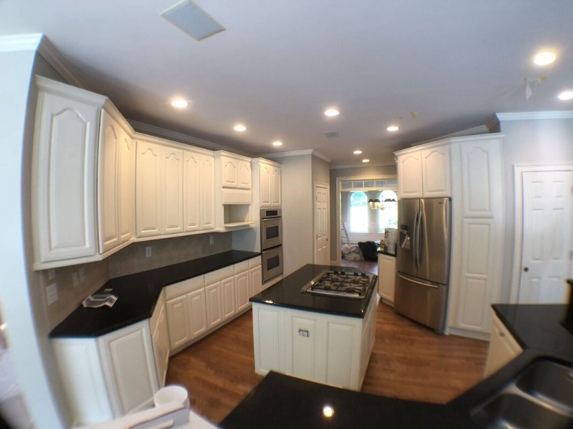 White kitchen cabinets. Cabinet painters